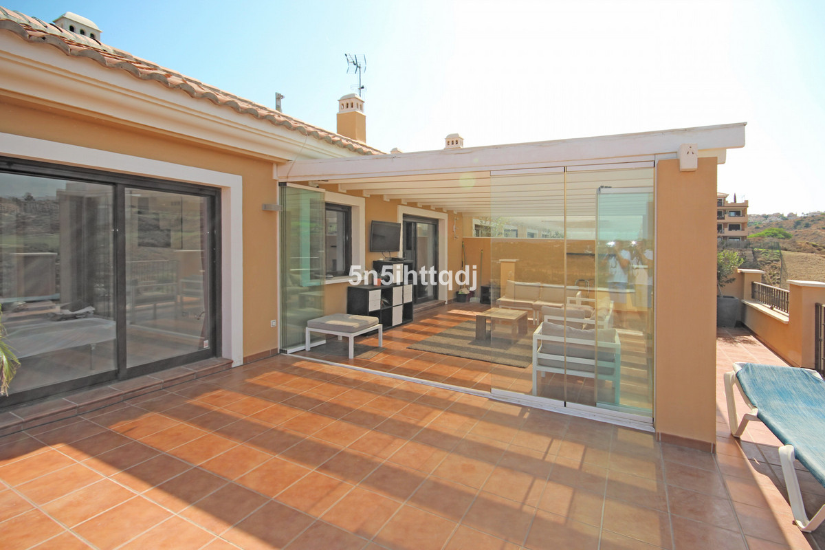 Penthouse within a gated community that offers a swimming pool and beautiful gardens, enjoying the a, Spain