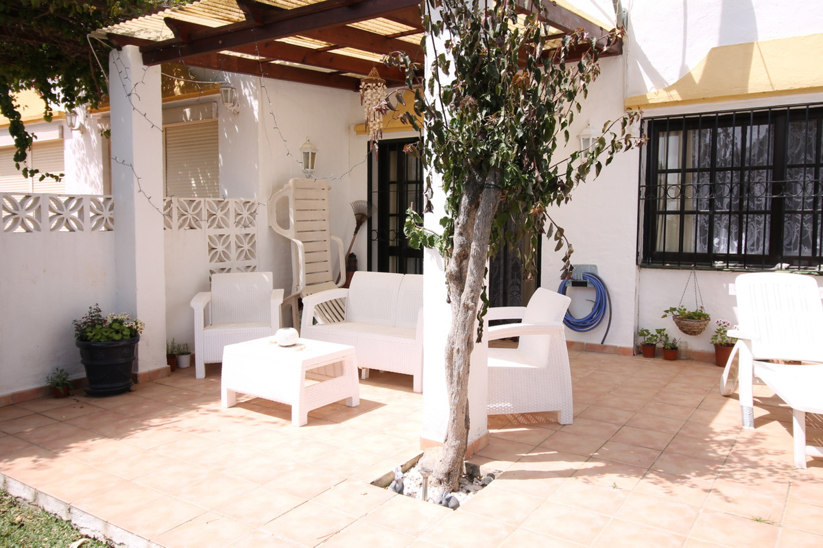A stunning semi-detached townhouse within walking distance of the beach and the centre of La Cala de,Spain