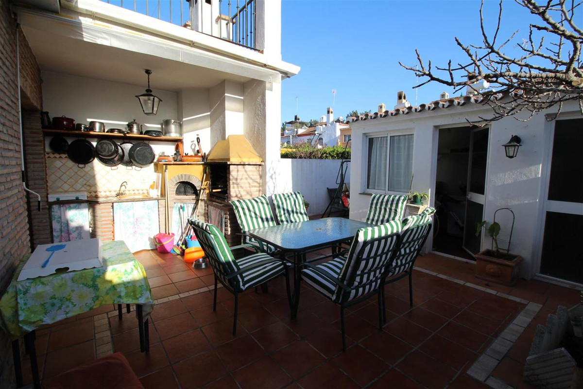 Spacious four bedroom townhouse situated in a small community comprising of only 13 houses, located ,Spain