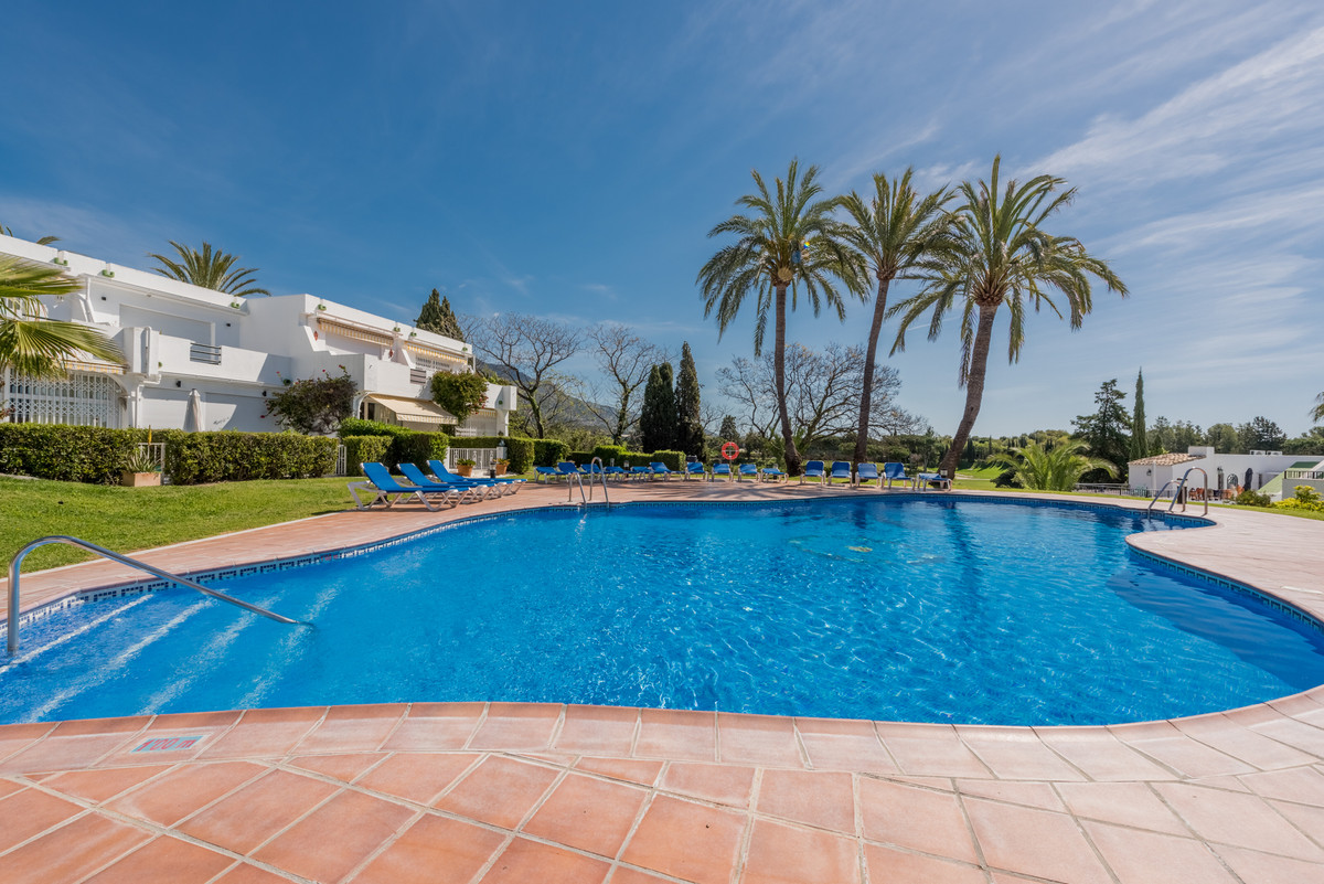 Ultra Modern two bedroom townhouse situated in an enviable position within a front line golf, gated , Spain
