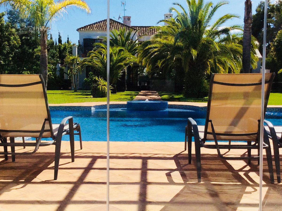 Lovely home with a contemporary interior on a beautiful plot in Guadalmina Baha. A two-level build a,Spain