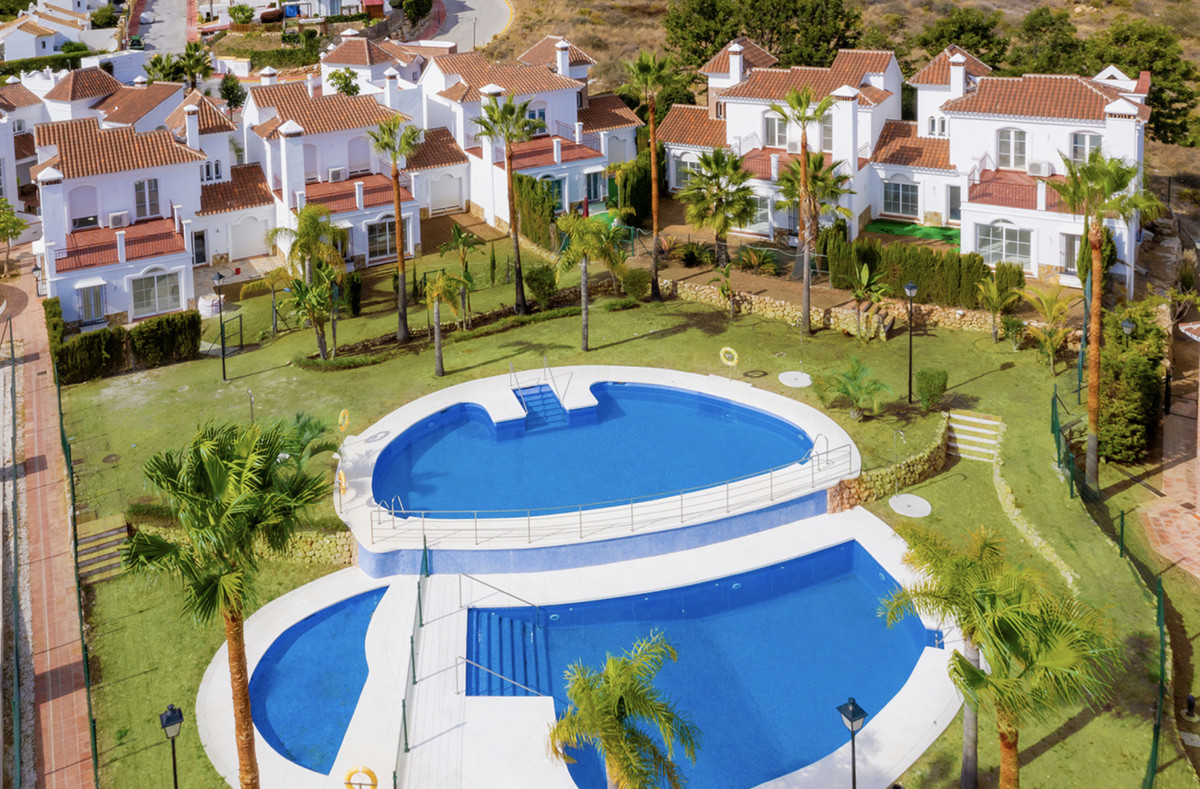 Andalusian Mediterranean town, in a closed area with large common areas, swimming pools and gardens.,Spain
