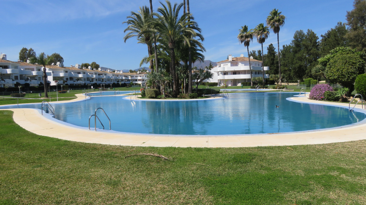 SPACIOUS 2 BED 2 BATH GROUND FLOOR GARDEN APARTMENT in beautifully kept Urbanisation within Mijas Go, Spain