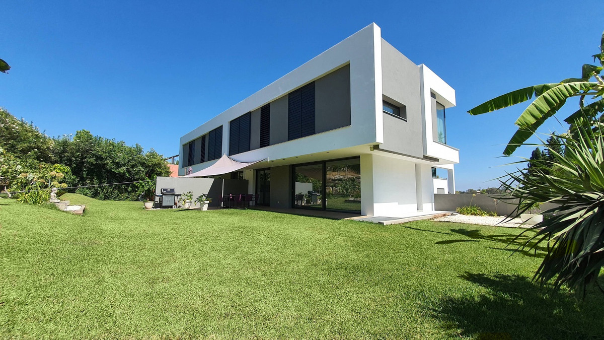 Two modern semi-detached houses on a plot next to the golf course. Luxury qualities with materials o,Spain
