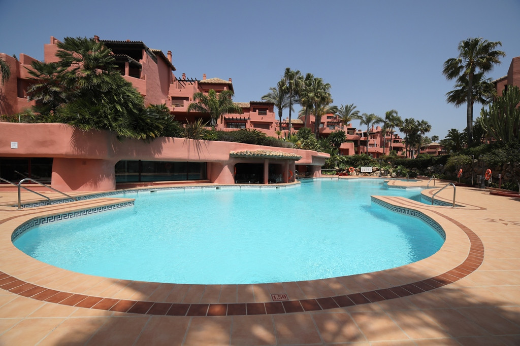 Beautifully presented two bedroom south west facing apartment in the prestigious gated community Men, Spain