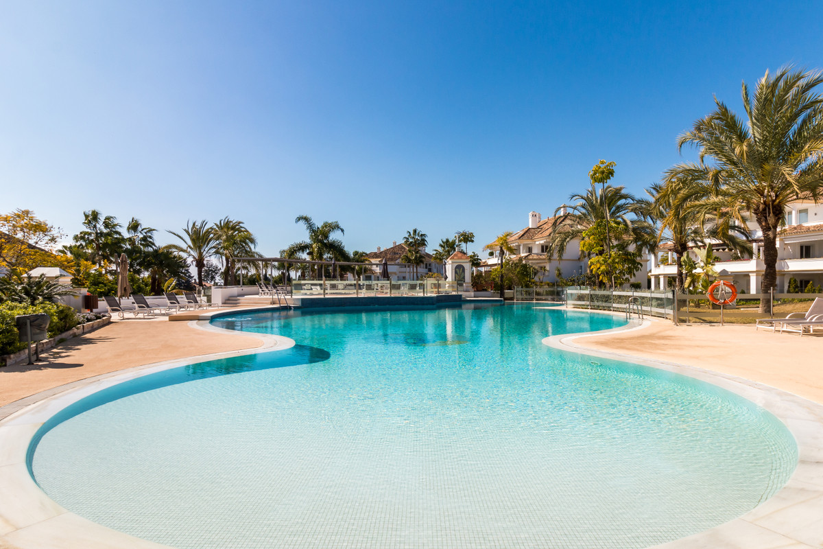 Stunning fully renovated three bedroom, south facing apartment in the exclusive and gated community ,Spain
