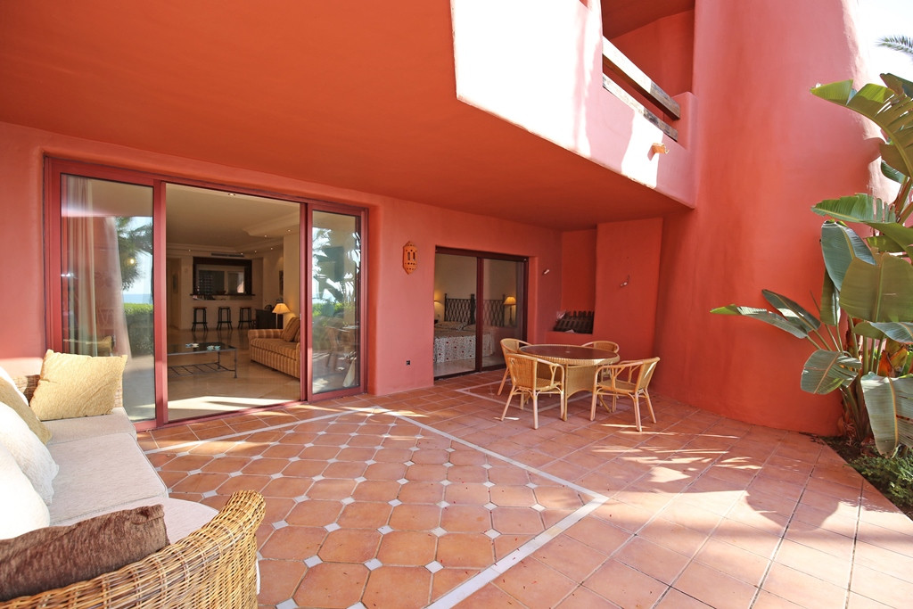 Fantastic two bedroom south facing ground floor apartment in the prestigious and gated beachfront co,Spain
