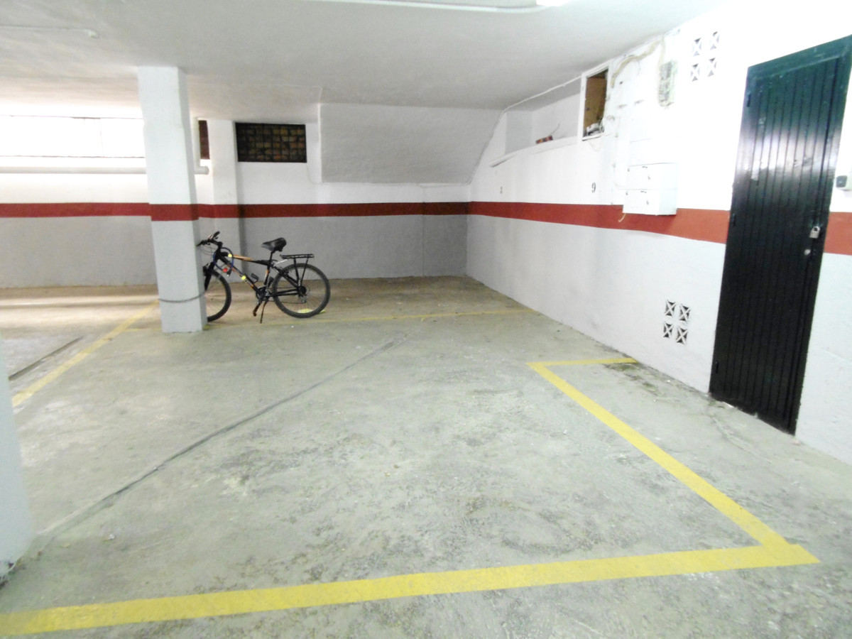 FREEHOLD - Large secure underground parking space only 110 metres from the paseo in Fuengirola. This,Spain
