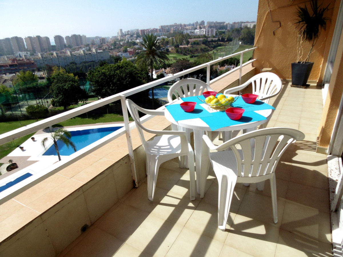 Sunny apartment for sale in Torremolinos with a large terrace and sea views. The property offers 2 d,Spain