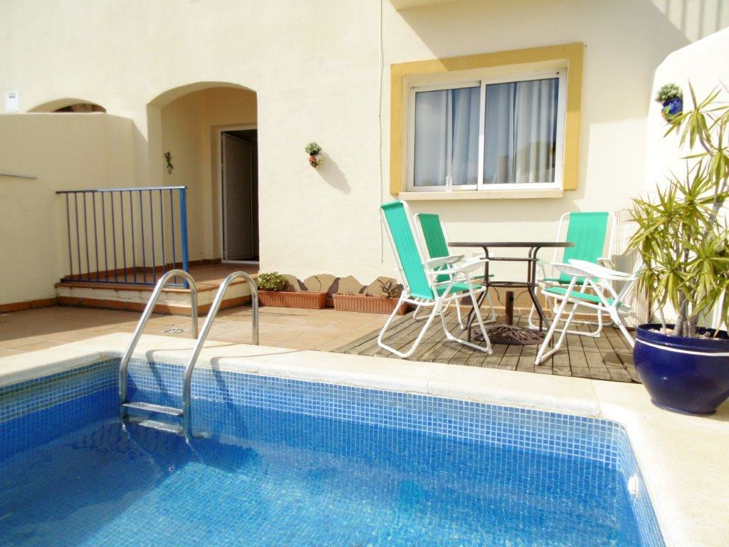Impressive townhouse for sale with its own pool in Torreblanca. Set on 3 levels, the access to the p,Spain
