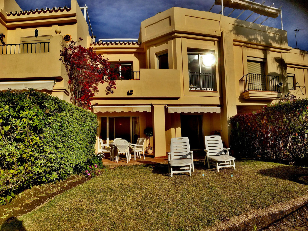 A beautiful 3 bedroom town house overlooking the famous La Quinta golf course.  Sunny, west facing t, Spain