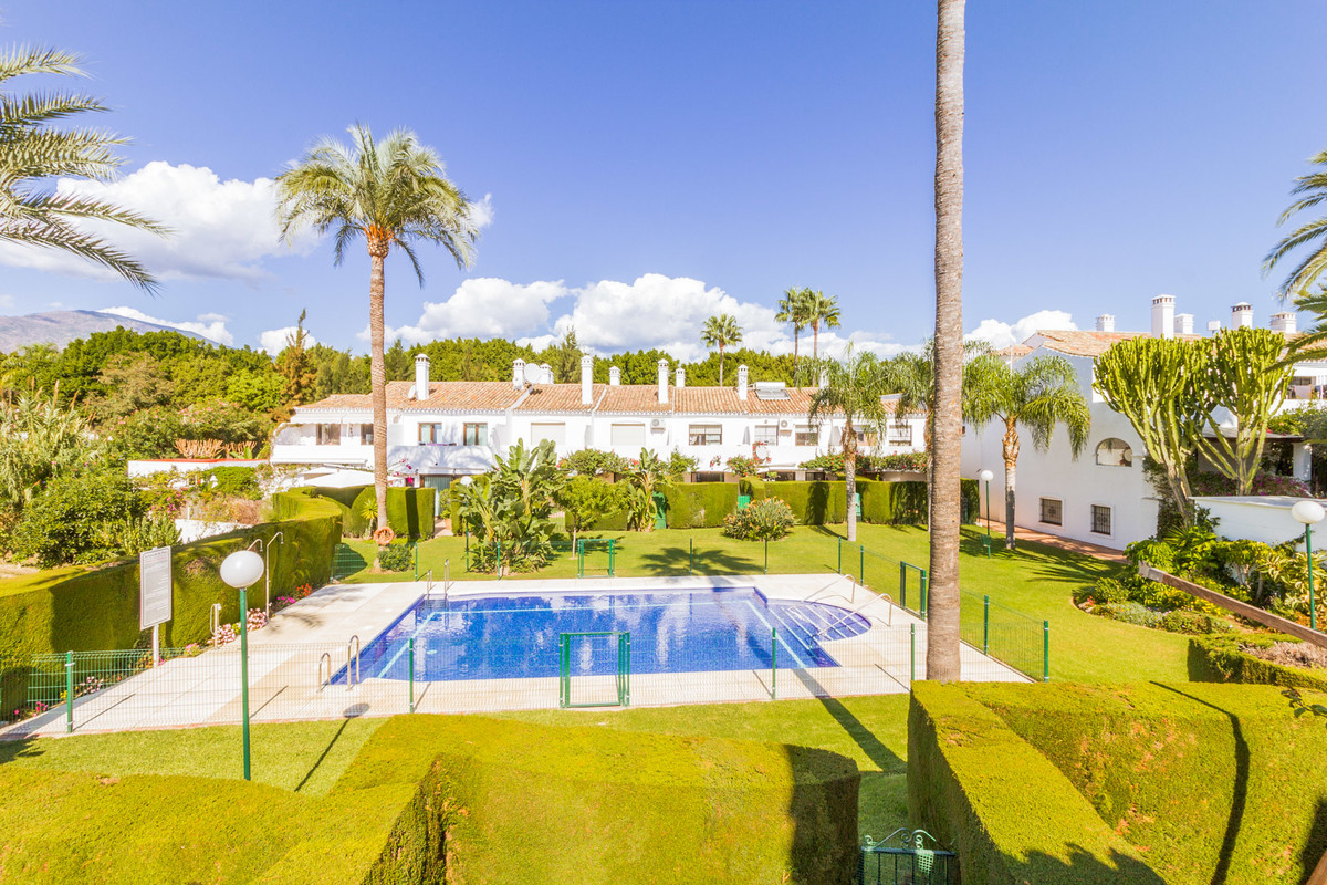 Beachside town house in private urbanization in Estepona  This lovely 116m2 town house in a small an, Spain
