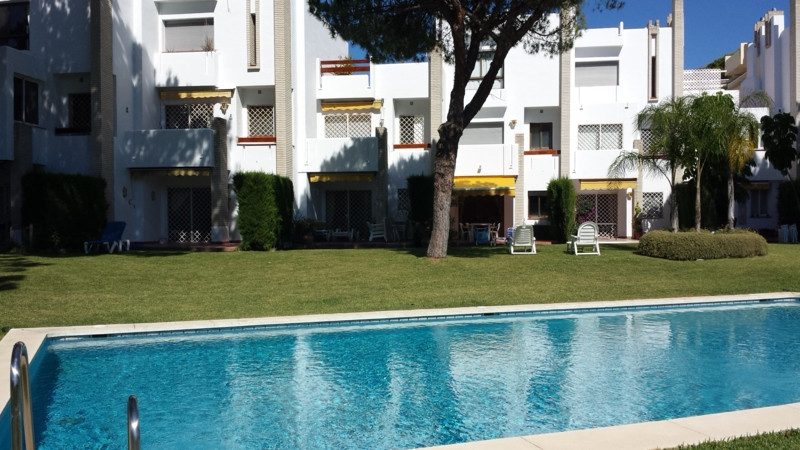 Surrounded by 12.000 m2 of gardens for only 12 properties and front of las Brisas Golf. This 3 bedro, Spain