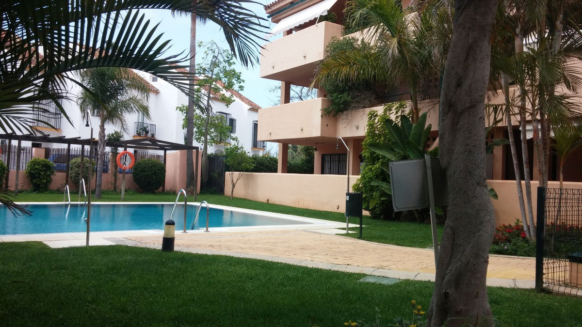 A charming two bedroom apartment in a quiet complex 50m from the beach at Las Chapas, one of the bes,Spain