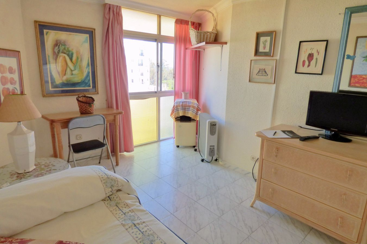 A studio in need of renovation, near the sea and surrounded by shops and restaurants.  The location,,Spain