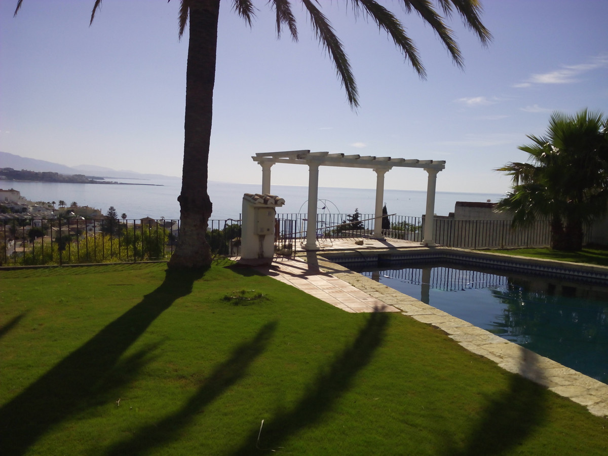 Stunning villa with views of the bay and mountain Estepona . The property is built on three levels. ,Spain