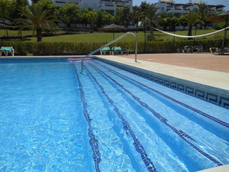 Middle Floor Apartment, Selwo, Costa del Sol. 3 Bedrooms, 2 Bathrooms, Built 121 m², Terrace 55 m².  Setting : Country, Beachside, Close To Sea, Close To Town, Close To Forest, Urbanisation. Orientation : East. Condition : Excellent. Pool : Communal, Children`s Pool. Climate Control : Hot A/C, Cold A/C. Views : Mountain, Panoramic, Garden, Pool. Features : Covered Terrace, Lift, Fitted Wardrobes, Near Transport, Private Terrace, Gym, Utility Room, Ensuite Bathroom, Marble Flooring, Double Glazing. Furniture : Fully Furnished. Kitchen : Fully Fitted. Garden : Communal, Landscaped. Security : Gated Complex, Entry Phone, 24 Hour Security. Parking : Garage, Covered, Communal, Private. Category : Cheap.