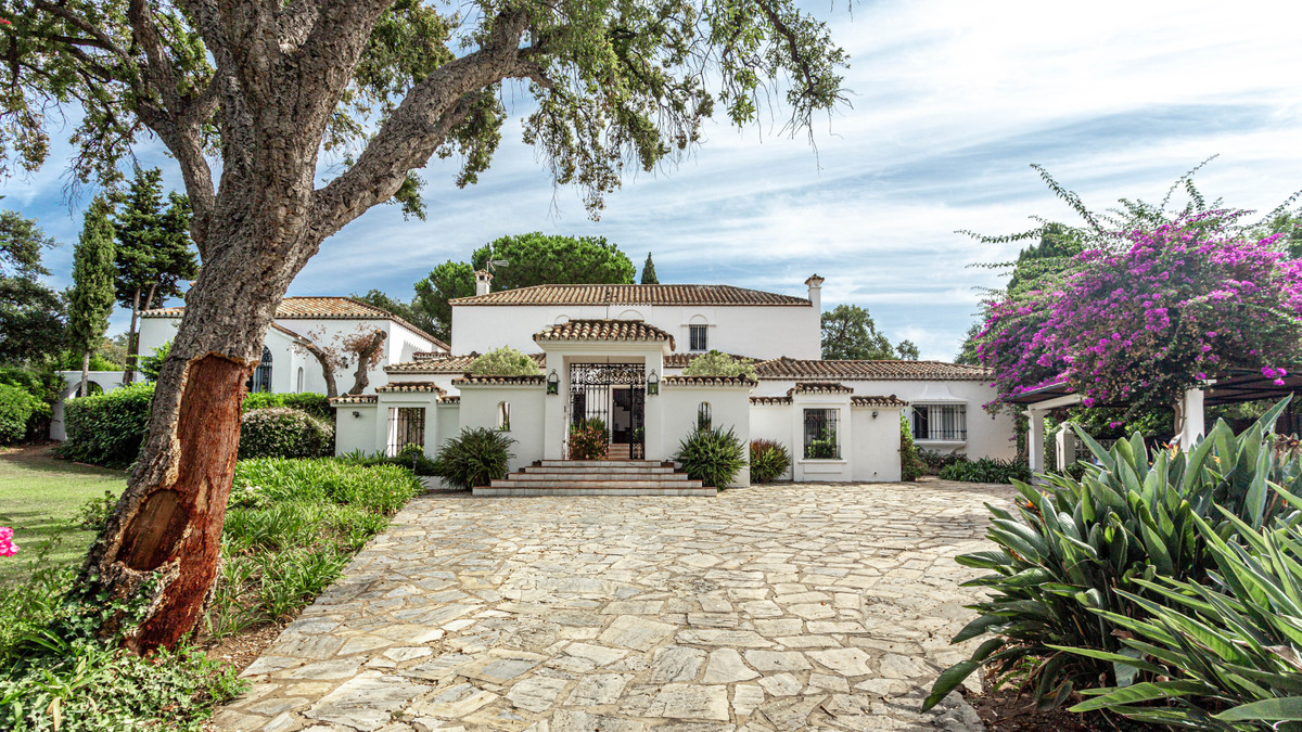 Andalusian style villa with courtyard surrounded by beautiful cork oaks in Sotogrande Costa. This Me,Spain