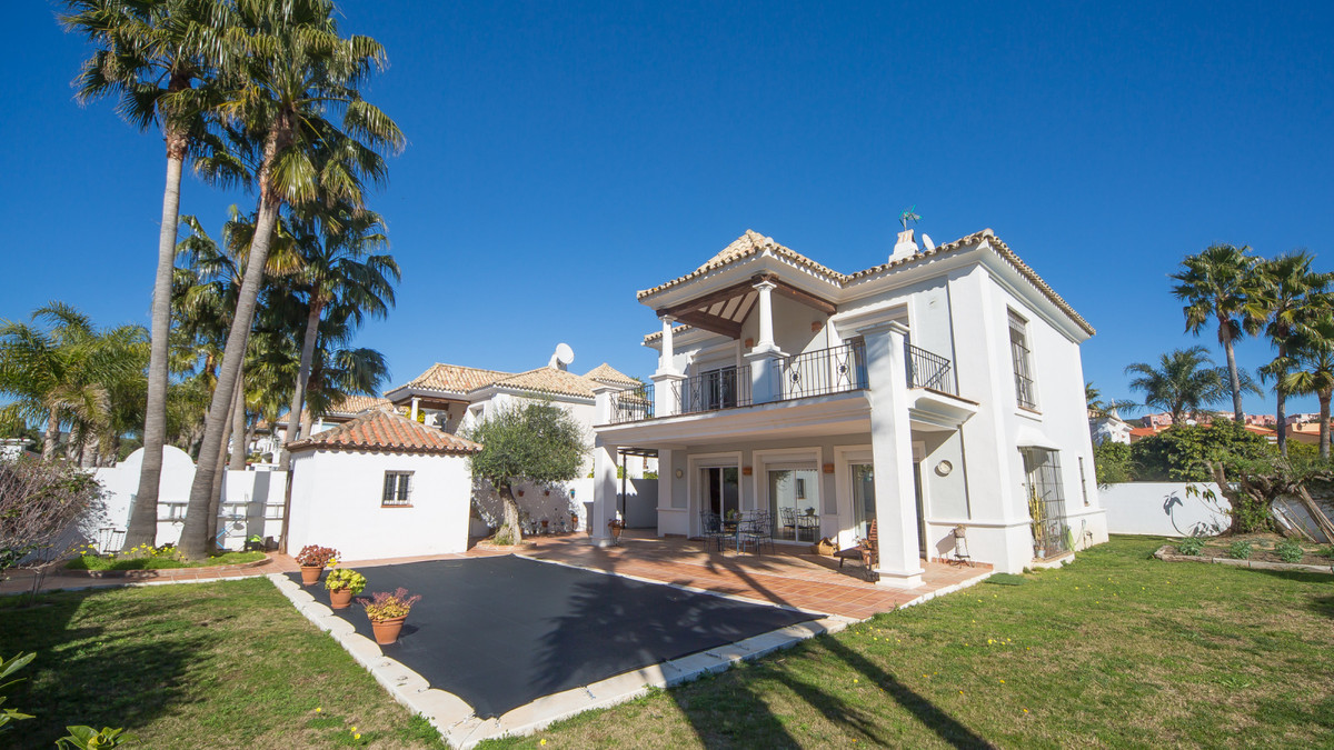 Welcome to this elegant detached villa with private swimming pool and big plot of land located nearb,Spain