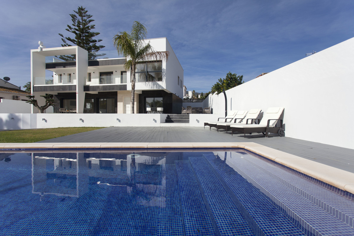 A superbly located contemporary villa only 400 meters away from Puerto Marina in Benalmadena Costa, ,Spain