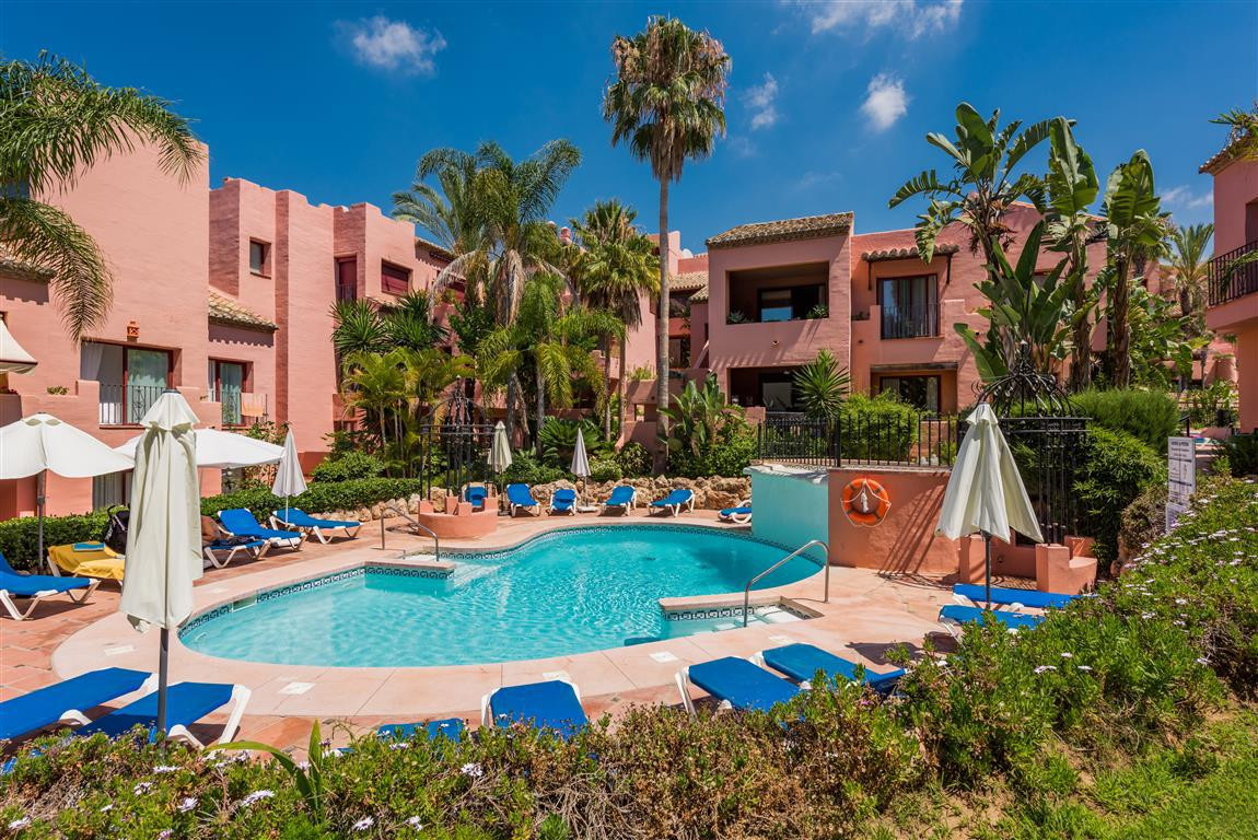 Set in one of the most desirable beachside Elviria private urbanisations, boasting mature fragrant g, Spain