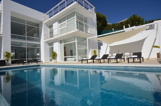 Stunning 4 bed, 4 bath cool and contemporary style villa with great views located on one of the best, Spain