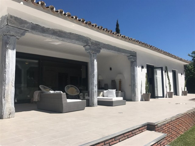Stunning villa situated in a very sought after urbanization in Marbella. The property has recently b, Spain
