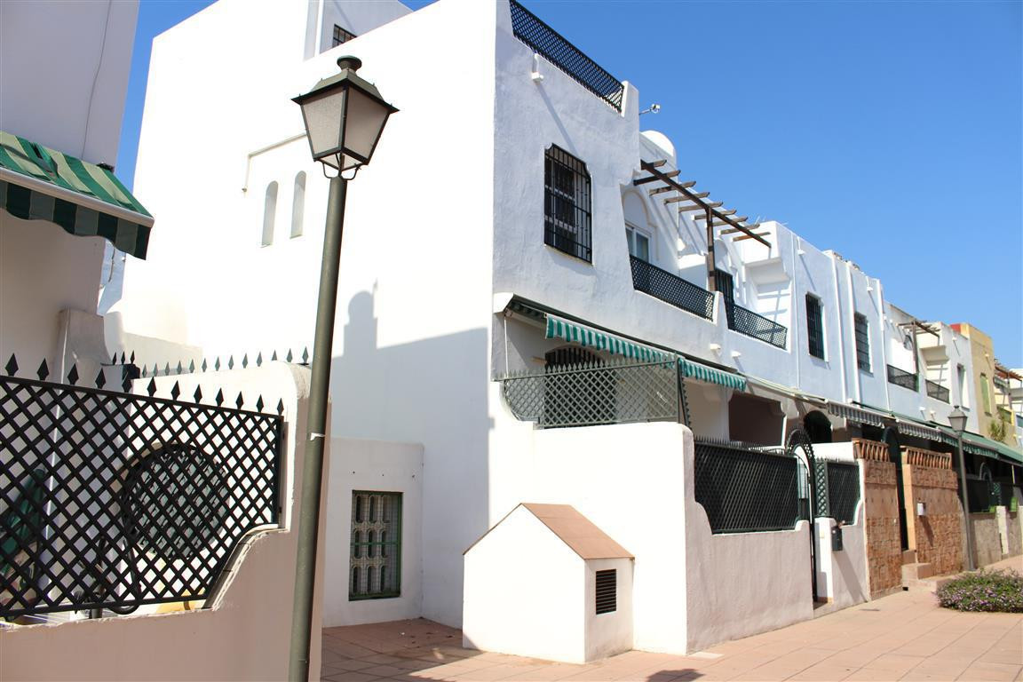 Marbella center, a corner townhouse  with four bedrooms, well distributed on three floors, with gara, Spain
