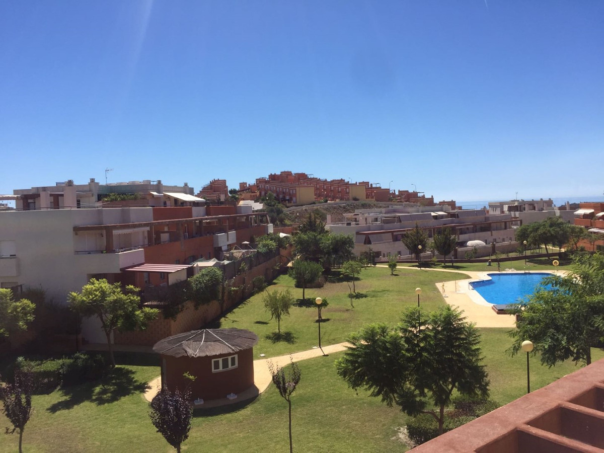 Beautiful penthouse in Benajarafe with views to the sea and the swimming pool, consists of a living ,Spain