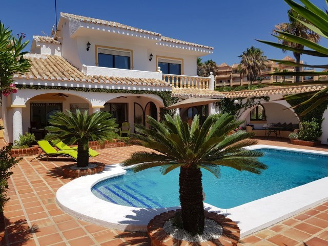 This villa is in a stunning and unique position, frontline to the beach with spectacular views to th, Spain