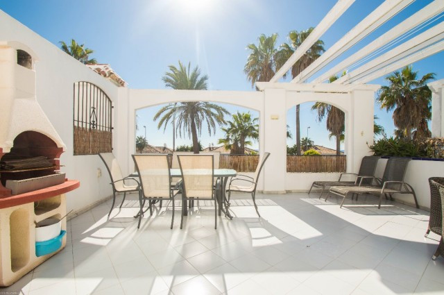 Bright apartment with large sunny terrace located a few meters from the beach and next to services. ,Spain