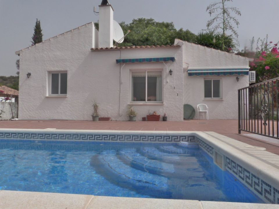 A lovely villa with gated entrance to ample parking, gardens, terraces and a swimming pool. The acco, Spain