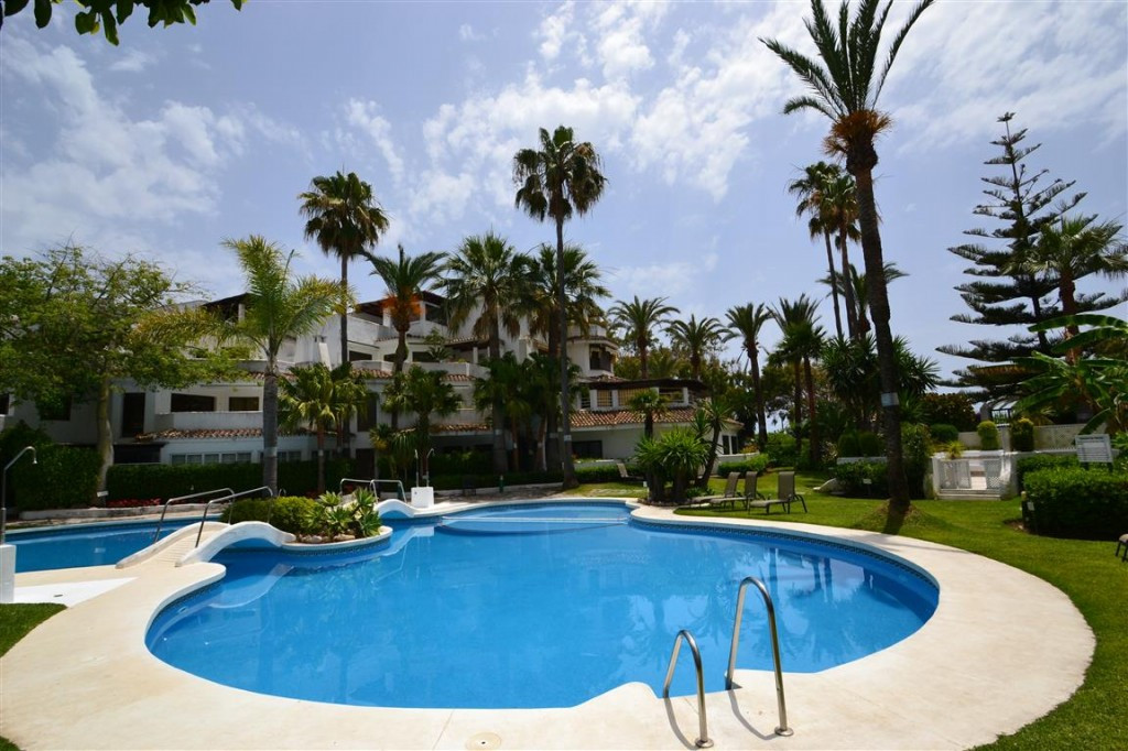 Beach-side holiday home for sale in Elviria, Marbella. Located in a beachfront urbanization literall, Spain