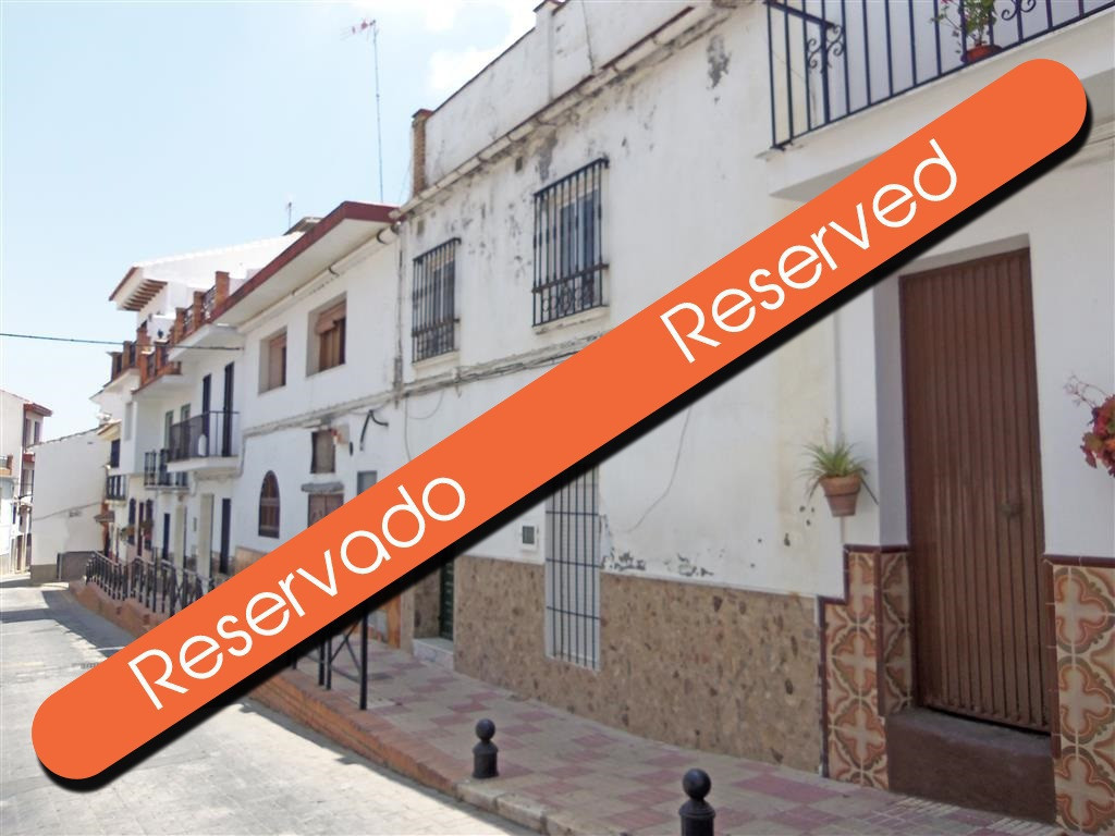 A very spacious townhouse situated in Monda that needs completely refurbishing but no structural wor,Spain