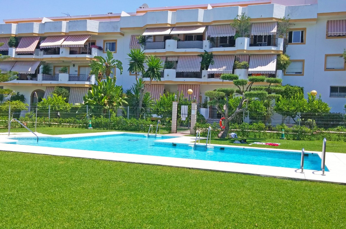 A spacious apartment with 4 bedrooms, 1 bathroom and separate WC, located in a very quiet area on th,Spain