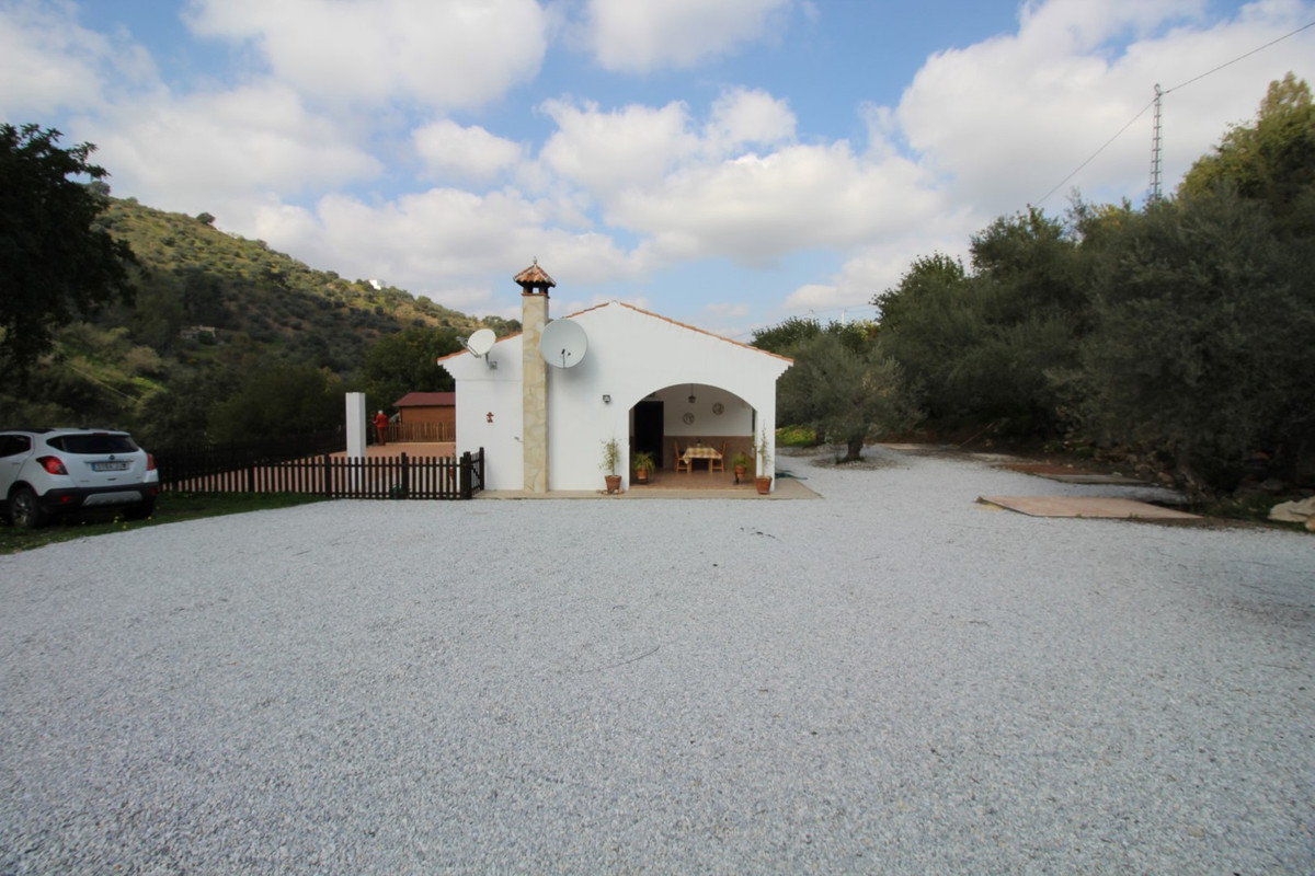 Beautiful finca with views of the mountains in Comares, consists of a living room with fireplace and, Spain