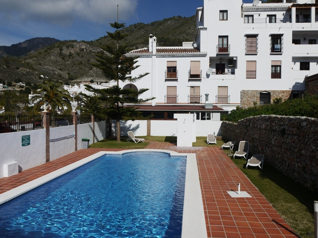 Located on the first floor of this small pueblo development, this property is spacious and well main, Spain