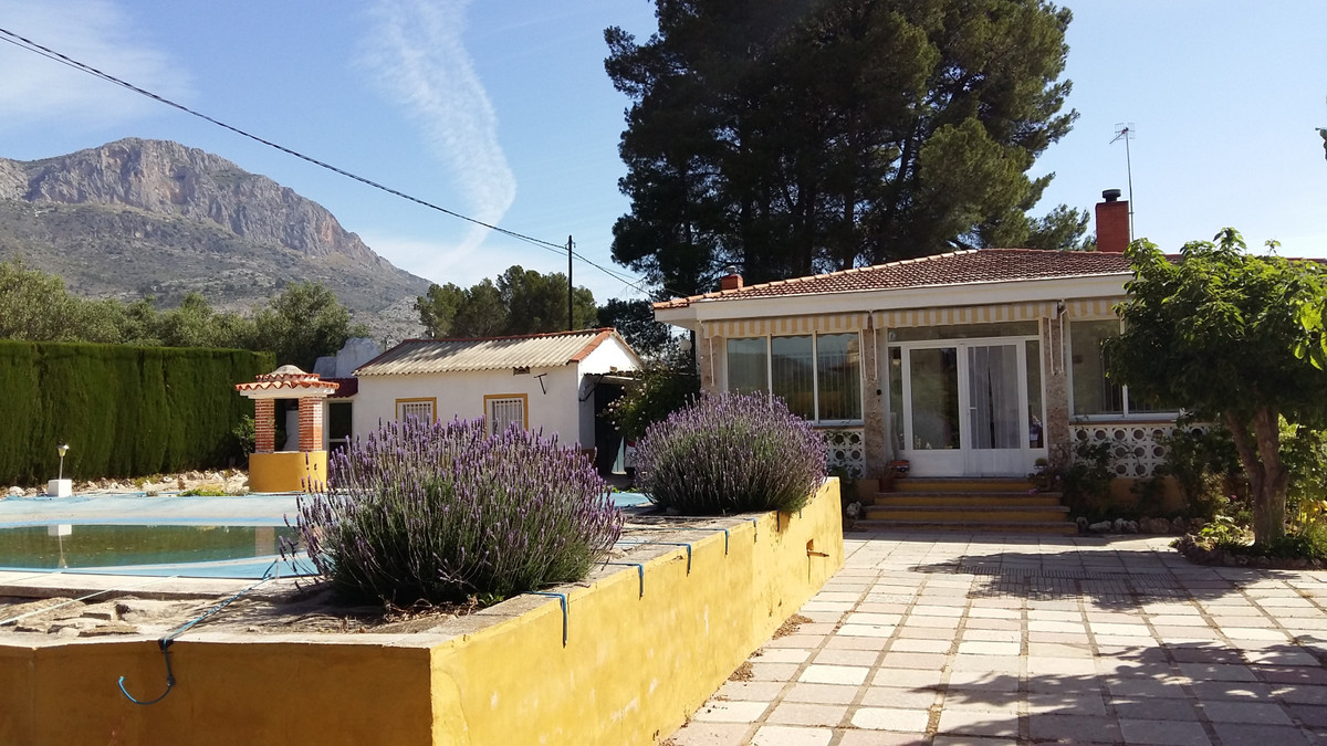 Charming 4 bedroom bungalow with very pretty fenced garden. Paved gated drive way with plenty of par Spain