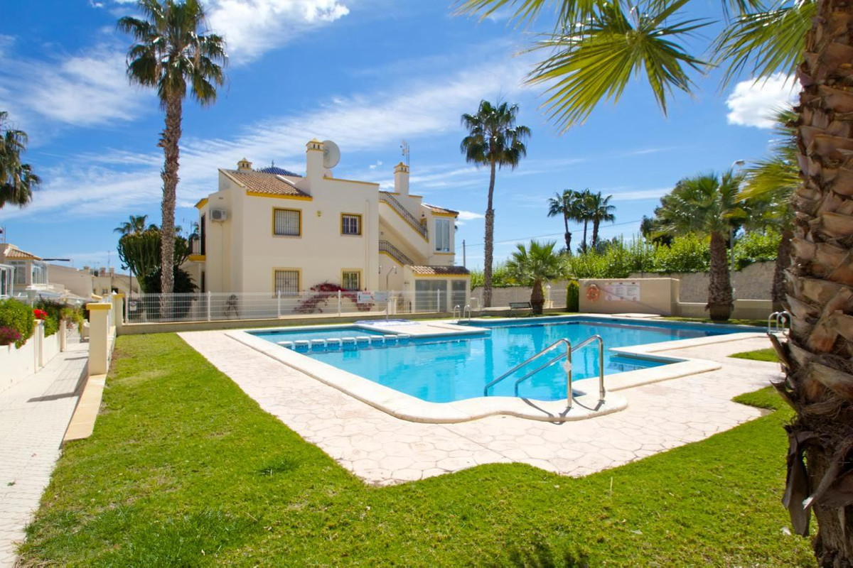SOUTH FACING 3 BEDROOM TOWNHOUSE IN VILLAMARTIN, ORIHUELA COSTA. This property is in a much sought a, Spain