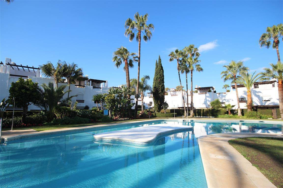 FULLY RENOVATED TO A HIGH STANDARD, A spacious  townhouse set in a beach side complex, with direct a, Spain