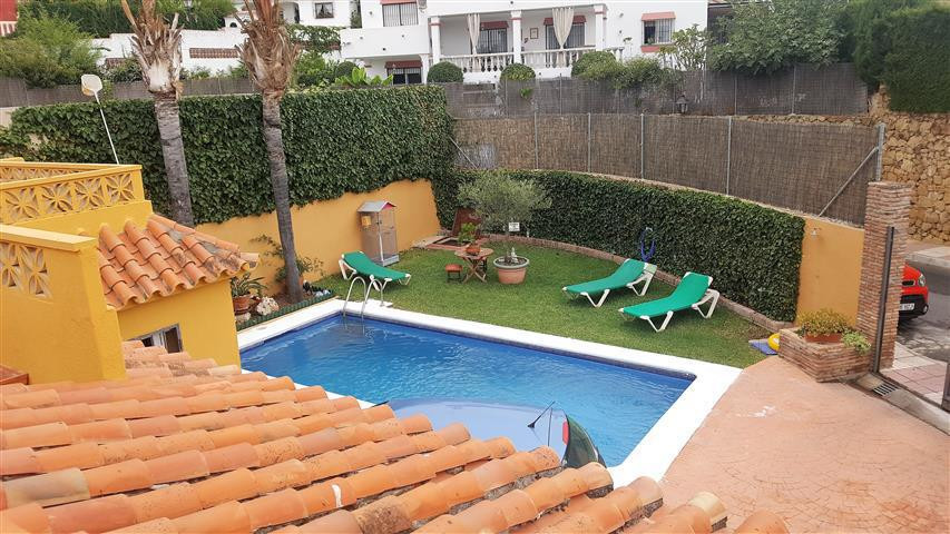 Large detached house with private pool, garden and parking space. It has access by two streets, one , Spain