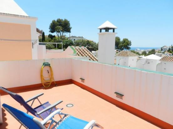 AN END OF TERRACE WEST FACING 3 BED TOWNHOUSE ON A POPULAR URBANIZATION CLOSE TO BURRIANA BEACH, NER, Spain