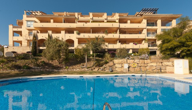 This lovely corner apartment is located inside a gated community in Calahonda just a short drive fro,Spain