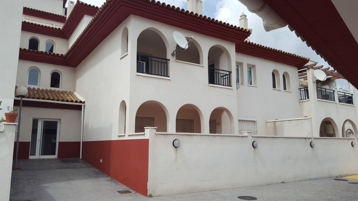 A two bed two bath apartment in a stepped urbanisation built into the Benalmadena Hills, in a quiet ,Spain