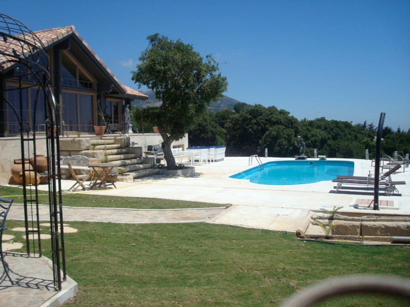 A stunning 4 bed/4 bath Scandanavian wooden chalet sited in an elevated position on the edge of a Na,Spain