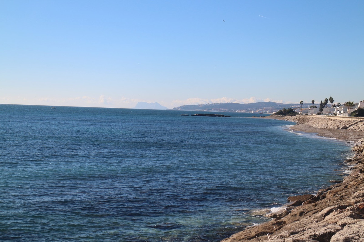 FIRST LINE BEACH PROPERTY. Just 5 minutes drive from Estepona is this fantastic townhouse house over,Spain