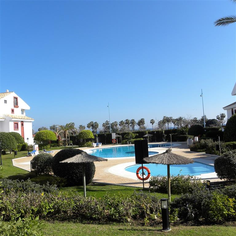This 3 bedroom ground floor apartment is for sale in the sought after beachside secure gated complex, Spain