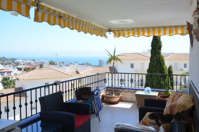 Two bedroom corner apartment with large terrace and panoramic views to the sea and mountains . Commu,Spain