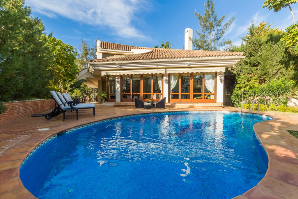 Beautiful east facing villa located in the secure and gated community of El Herrojo Alto, above the ,Spain