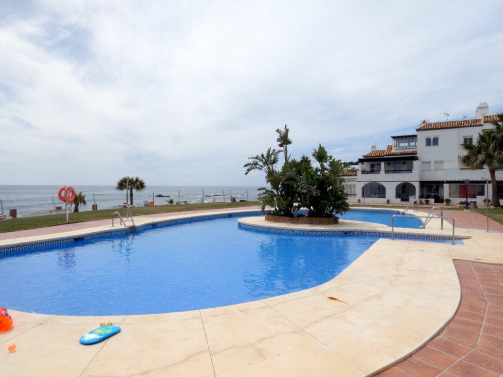 A great 2 bedroom beach side property, sea views, fully equipped and only 20 meters from the sea. Pl,Spain